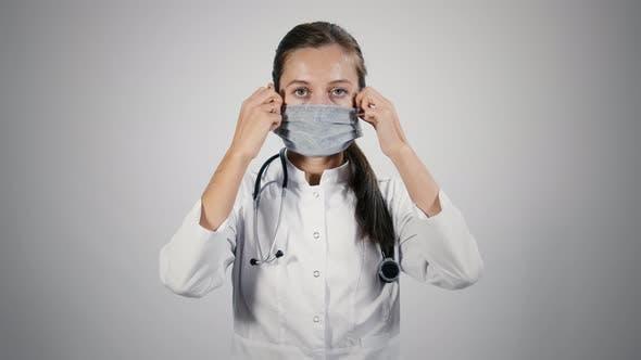 Doctor in medical mask puts off medical mask