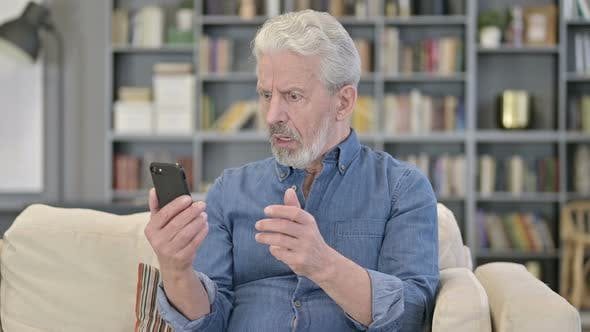 Old Man Reacting To Failure on Smartphone