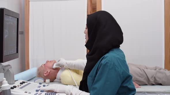Thumbnail for Muslim Doctor Making Ultrasound