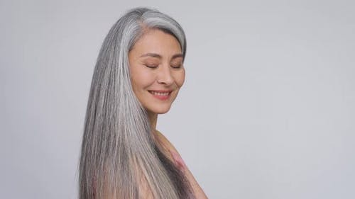 Happy Middle Aged Mature Asian Woman Portrait Smiling Looking at Camera