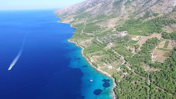 Thumbnail for Aerial view of a boat passing sandy beach on the island of Brac, Croatia