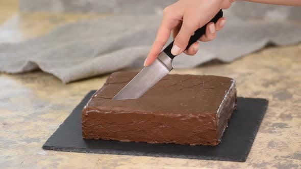 Thumbnail for Female Hand Cutting Chocolate Cake with Knife