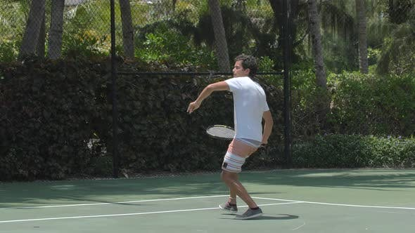 Thumbnail for A boyfriend playing tennis against his girlfriend while on vacation.