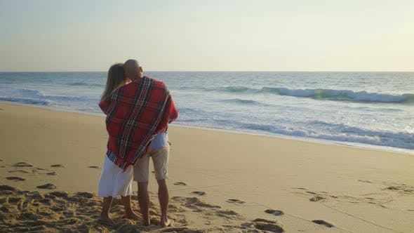 Thumbnail for Couple Hugging and Kissing on Beach