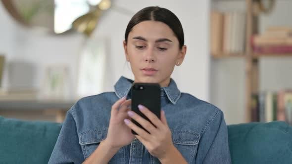 Thumbnail for Latin Woman Using Smartphone