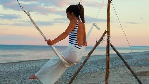 Cover Image for Girl on the Swing in front of the Ocean