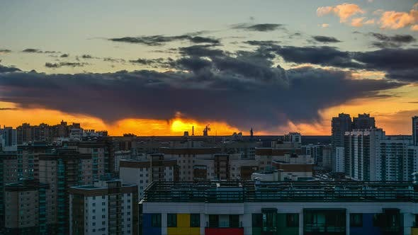 time-lapse of a beautiful city sunset against the background of residential buildings