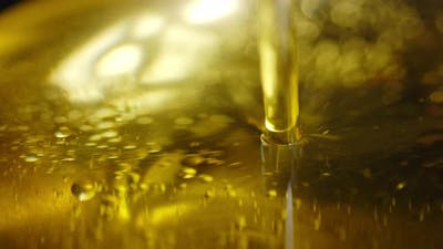 Olive Oil with Air Bubbles. Macro Background. The Texture of Olive Oil.