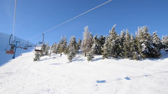 On a Ski Lift in Mountains