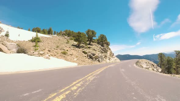 POV point of view -  Driving on mountain highway in the Summer.