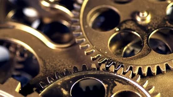 Closeup Old Golden Gears Turning In Working Mechanism