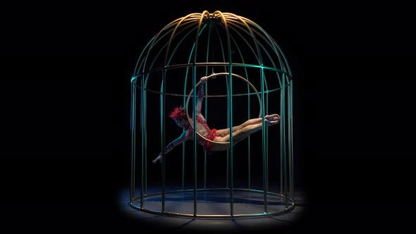 Thumbnail for Girl Art Acrobatics on a Rotating Hoop in a Metal Cage, Black Background