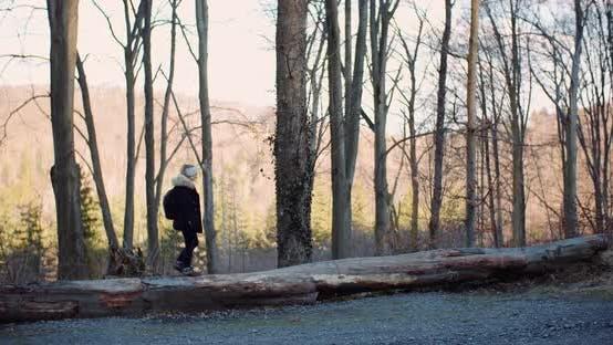 Thumbnail for Female Tourist Walking in Mountain Trail