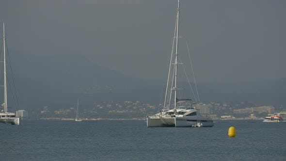 Thumbnail for Catamaran yachts and other tourists boats