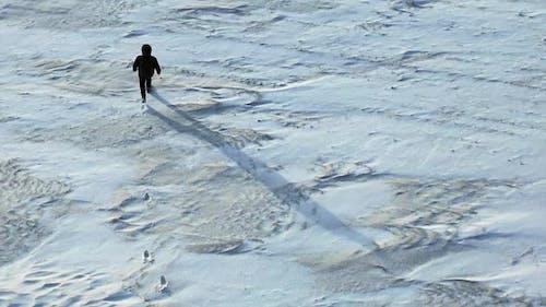 Human Walk Throw the Snowfield
