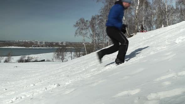 Thumbnail for Side View Of Man Running Up The Hill In Winter