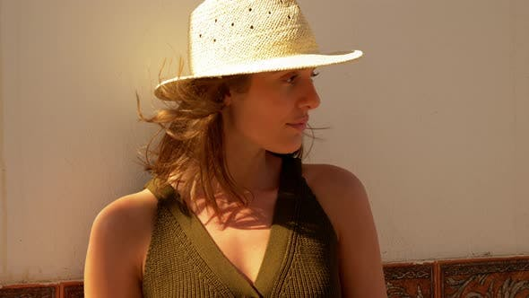 Thumbnail for Brown Haired Woman Wearing Straw Hat on a Sunny Day