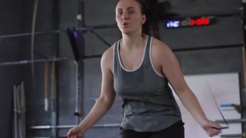 Female Fighter Jumping Rope in Gym