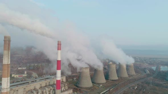 Aerial View of an Industrial Zone Pipes Pouring Thick White Smoke