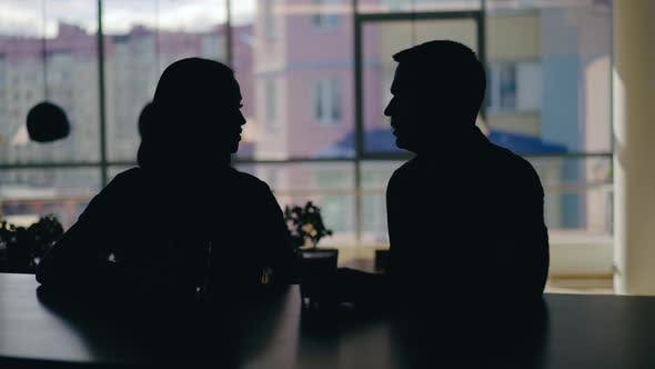 Cover Image for Silhouettes of Man and Woman