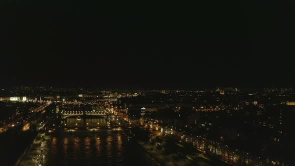 Thumbnail for AERIAL: View Over Seine River at Night in Paris, France with View on Eiffel Tower, Tour Eiffel