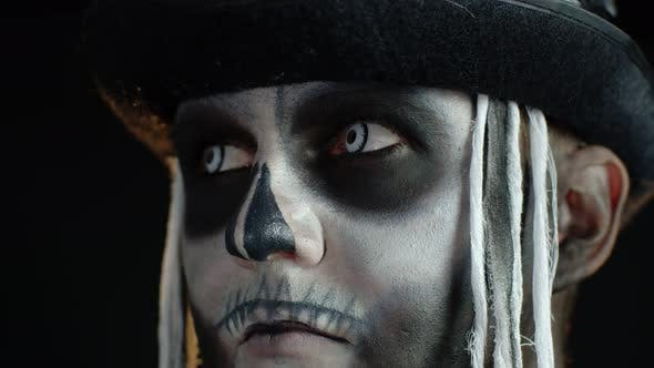 Thumbnail for Close-up Shot of Creepy Man in Skeleton Halloween Makeup Opening Eyes and Looking Spooky at Camera