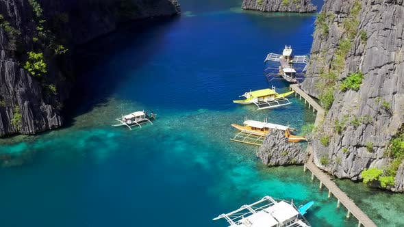 Cover Image for Traditional Boats in Clear Water on Blue Sea. Coron Island, Palawan, Philippines. Aerial View
