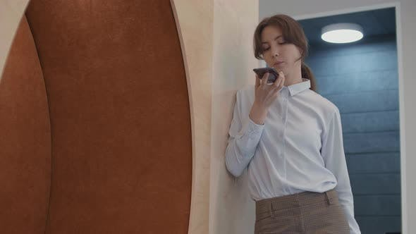 Caucasian Businesswoman Having Phone Talk in Office