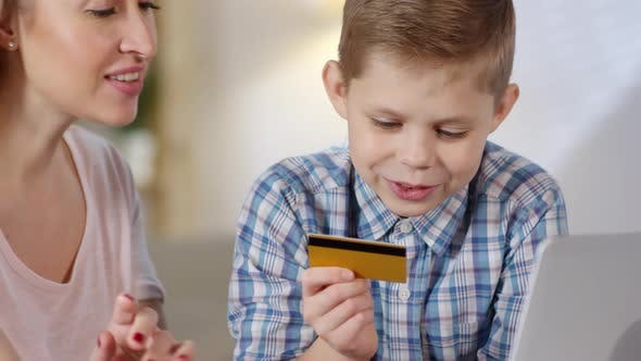 Cover Image for Mother and Son Shopping Online and Talking