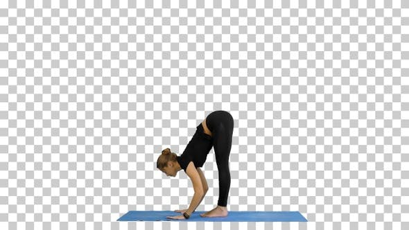 Young woman doing yogic sun salutation pose on mat, Alpha Channel