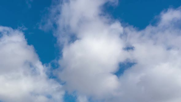 Time lapse of moving clouds in blue sky