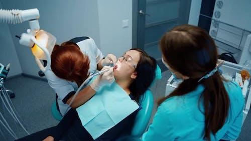 Professional female stomatologist at work