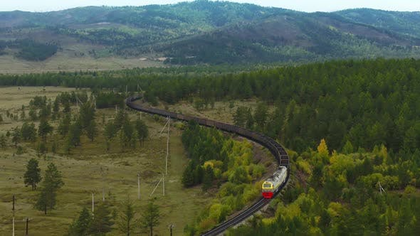 A Freight Train Is Carrying Coal Through the Forests