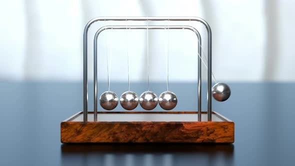 Thumbnail for Newton's Cradle on Office Table