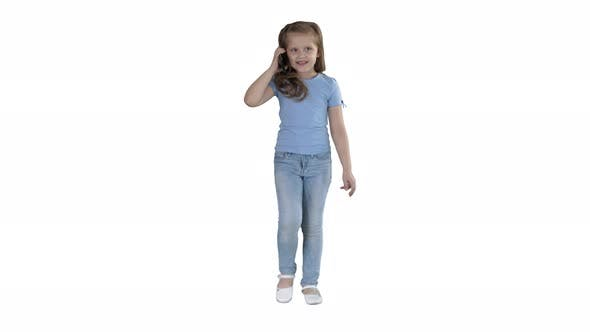 Thumbnail for Little Cute Girl Making a Phone Call While Walking on White Background.