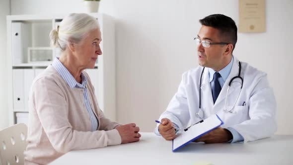 Thumbnail for Senior Woman and Doctor with Cardiogram at Clinic