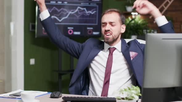 Thumbnail for Happy Businessman Starts Dancing at His Desk