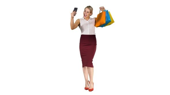 Thumbnail for Cheerful Woman with Shopping Bags Taking Selfie on White