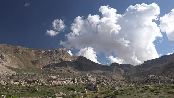 Thumbnail for Clouds in Treeless Arid Mountainous Hills