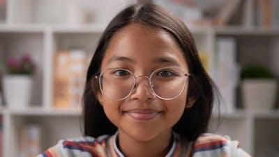 Girl glasses looking at camera