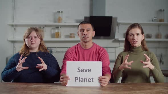 Deaf People Showing Save Planet on Sign Language