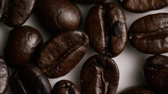 Thumbnail for Rotating shot of delicious, roasted coffee beans on a white surface - COFFEE BEANS 035