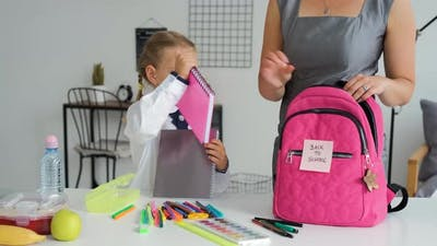 Pupil Girl with Mom Preparing Backpack for School