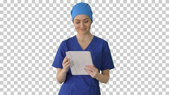 Smiling female nurse using tablet computer, Alpha Channel