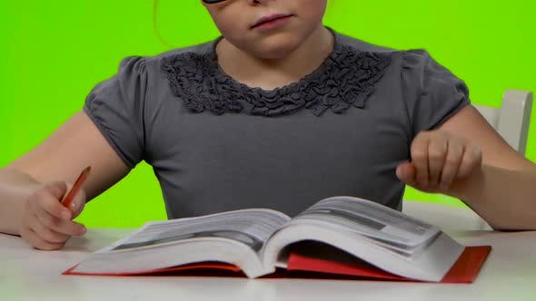 Thumbnail for Girl Leafing Through a Book of Interesting Looks for Another. Green Screen. Close Up