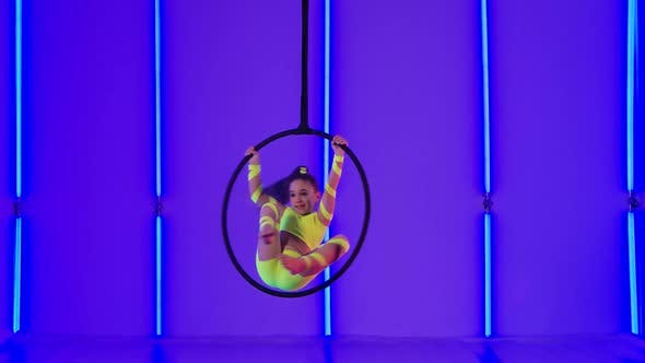 Thumbnail for Young Aerial Gymnastic Perform Acrobatic Stunts on an Air Hoop