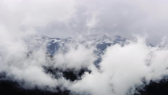 Thumbnail for Clouds Almost Covering Mountain Peak