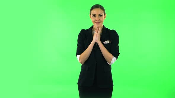 Thumbnail for Tender Girl with Folded Arms in Front of Her and Tears in Her Eyes. Green Screen