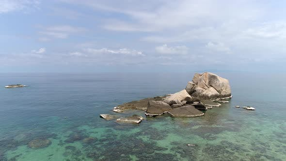 Thumbnail for Flight to a Big Stone Over  Coral Lagoon