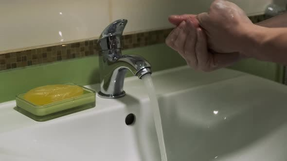 Thumbnail for Woman Washing Her Hands with Soap in the Bathroom To Eliminate Germs and Protect Against the Virus